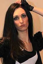 Ukrainian girl Antonina,28 years old with green eyes and black hair.