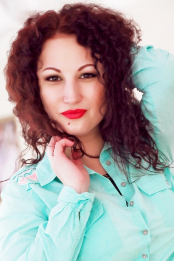 Ukrainian girl Ylia,26 years old with grey eyes and red hair.