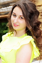 Ukrainian girl Anastasia,21 years old with brown eyes and dark brown hair.