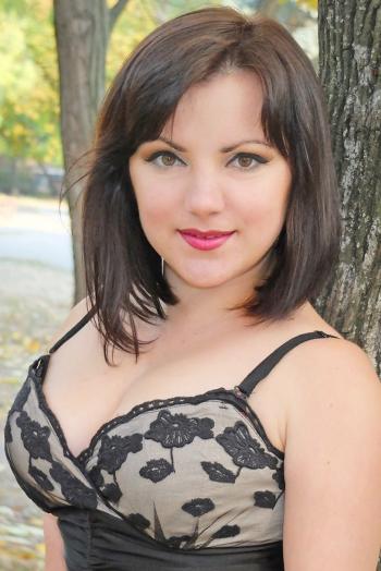 Ukrainian girl Nadezhda,29 years old with brown eyes and dark brown hair.