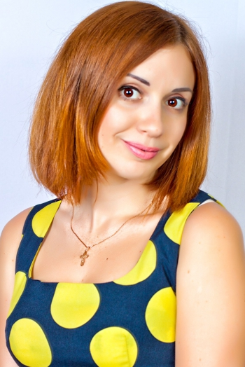 Ukrainian girl Viktoria,32 years old with hazel eyes and dark brown hair.