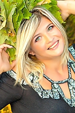 Ukrainian girl Irina,36 years old with grey eyes and blonde hair.