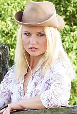 Ukrainian girl Olga,23 years old with blue eyes and blonde hair.
