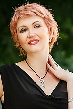 Ukrainian girl Tatiana,49 years old with green eyes and blonde hair.