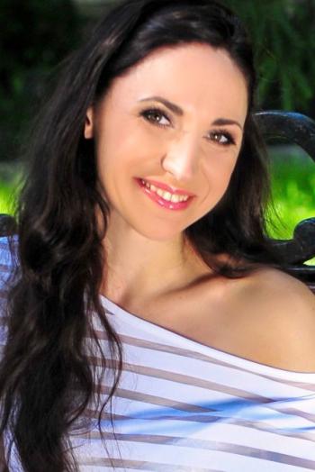 Ukrainian girl Viktoriya,36 years old with brown eyes and dark brown hair.