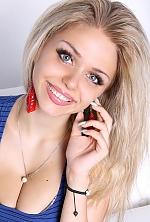Ukrainian girl Lidia,23 years old with grey eyes and light brown hair.