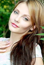 Ukrainian girl Veronica,24 years old with green eyes and light brown hair.