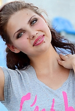 Ukrainian girl Rima,20 years old with blue eyes and dark brown hair.