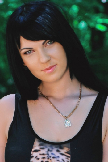 Ukrainian girl Valentina,29 years old with green eyes and black hair.