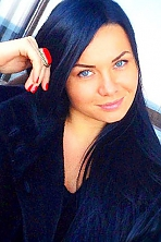 Ukrainian girl Olga,33 years old with blue eyes and black hair.