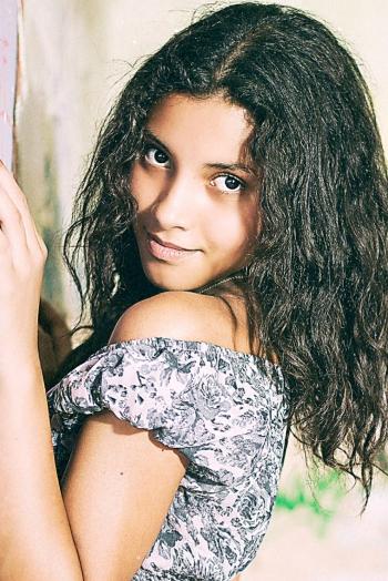 Ukrainian girl Maryam,19 years old with brown eyes and black hair.