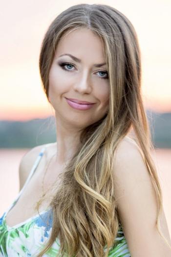 Ukrainian girl Irina,32 years old with blue eyes and blonde hair.