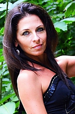 Ukrainian girl Anna,50 years old with blue eyes and black hair.