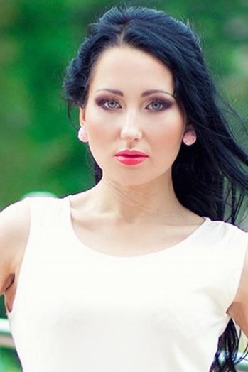 Ukrainian girl Olga,29 years old with blue eyes and black hair.