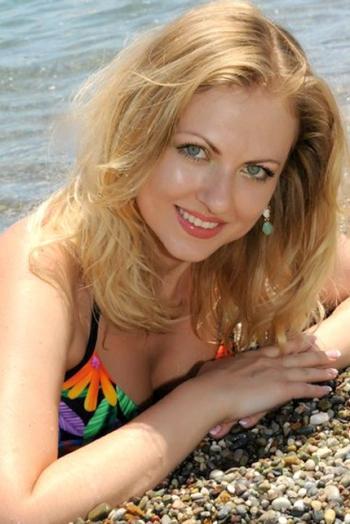 Ukrainian girl Olya,34 years old with blue eyes and blonde hair.