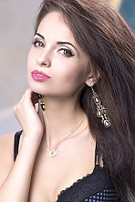 Ukrainian girl Svetlana,25 years old with hazel eyes and black hair.