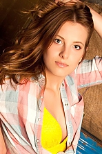 Ukrainian girl Anna,23 years old with grey eyes and light brown hair.