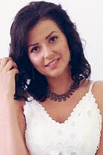 Ukrainian girl Rita,20 years old with hazel eyes and dark brown hair.