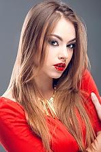Ukrainian girl Olya,22 years old with blue eyes and dark brown hair.