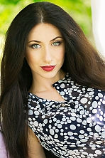 Ukrainian girl Ludmila,25 years old with green eyes and dark brown hair.