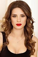 Ukrainian girl Darina,26 years old with brown eyes and dark brown hair.