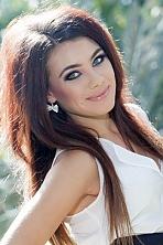 Ukrainian girl Ekaterina,24 years old with grey eyes and dark brown hair.