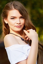 Ukrainian girl Yana,19 years old with green eyes and white grey hair.