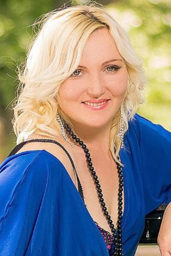 Ukrainian girl Lyudmila,40 years old with grey eyes and blonde hair.
