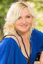 Ukrainian girl Lyudmila,40 years old with grey eyes and blonde hair.