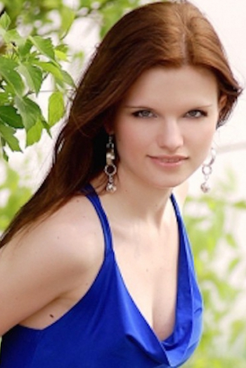Ukrainian girl Ulyana,26 years old with green eyes and red hair.