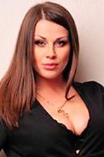 Ukrainian girl Anna,30 years old with grey eyes and dark brown hair.