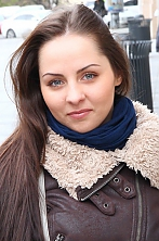 Ukrainian girl Alena,24 years old with brown eyes and dark brown hair.