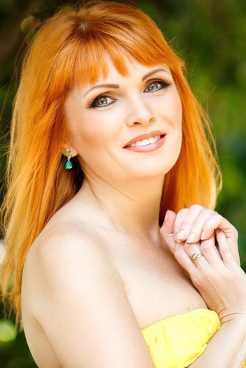 Ukrainian girl Oksana,46 years old with grey eyes and light brown hair.
