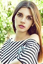 Russian girl Karina,19 years old with brown eyes and black hair.