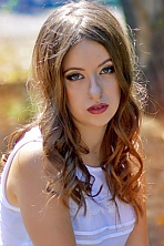 Ukrainian girl Irina,20 years old with brown eyes and dark brown hair.