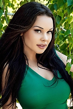 Ukrainian girl Anna,25 years old with green eyes and black hair.