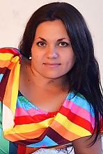 Ukrainian girl Tatyana,31 years old with green eyes and dark brown hair.