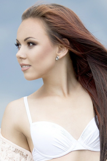 Ukrainian girl Sofiya,20 years old with hazel eyes and dark brown hair.