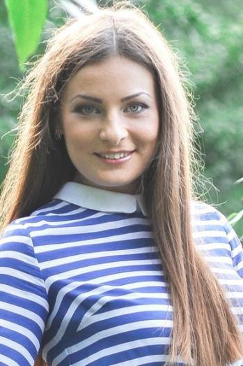 Ukrainian girl Irina,26 years old with blue eyes and light brown hair.