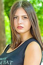 Ukrainian girl Viktoria,19 years old with hazel eyes and dark brown hair.
