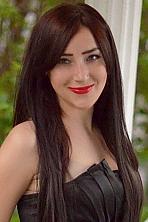 Ukrainian girl Aksa,24 years old with green eyes and dark brown hair.