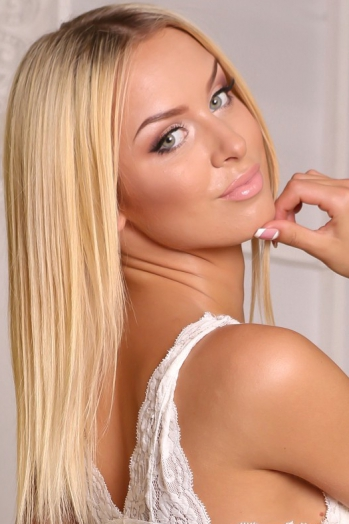 Ukrainian girl Elena,23 years old with green eyes and blonde hair.