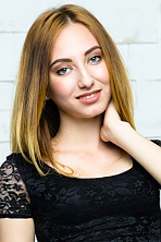 Ukrainian girl Anna,21 years old with green eyes and light brown hair.