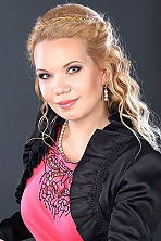 Ukrainian girl Alena,32 years old with green eyes and blonde hair.