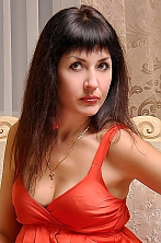 Ukrainian girl Evgeniya,44 years old with hazel eyes and dark brown hair.