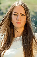 Ukrainian girl Anuta,21 years old with blue eyes and light brown hair.