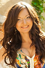 Ukrainian girl Anasasia,31 years old with brown eyes and light brown hair.