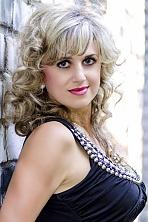 Ukrainian girl Tatiana,37 years old with blue eyes and light brown hair.