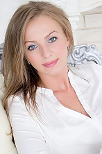 Ukrainian girl Anna,32 years old with grey eyes and blonde hair.