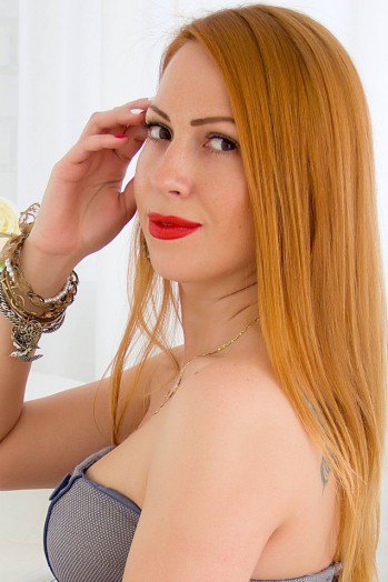 Ukrainian girl Galina,34 years old with brown eyes and red hair.